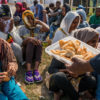 Calais, France. 9th August 2015 -- Christian migrants praying at the church in Jungle makeshift camp near Calais.